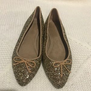 Gold sparkly flats